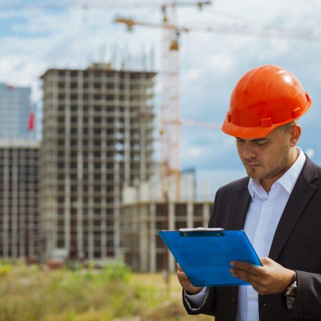 Worker inspector  in helmet checking  construction