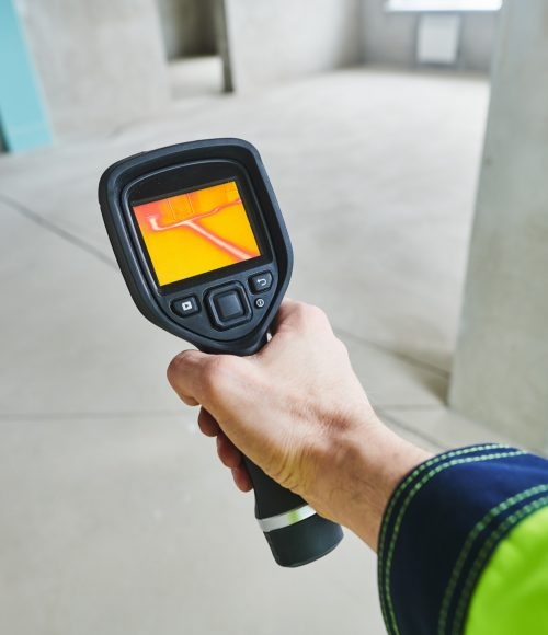 thermal imaging camera inspection of construction building to check temperature and finding heating pipes in floor